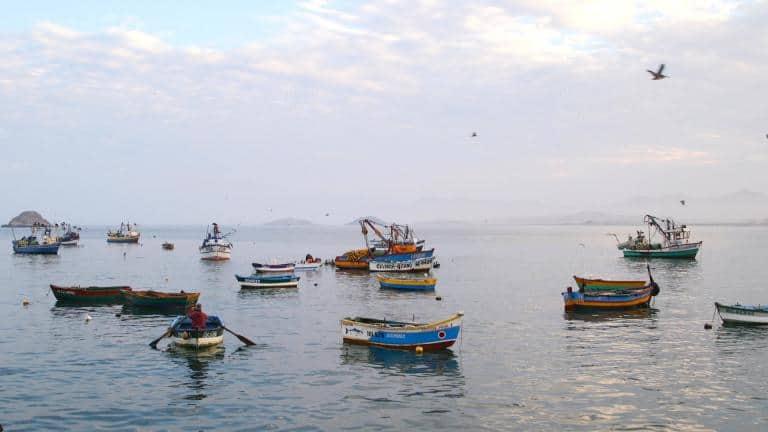 Boats bob next to the tiny fishing village of Puerto Huarmey, Peru. (Jimmy Chalk/GlobalPost)