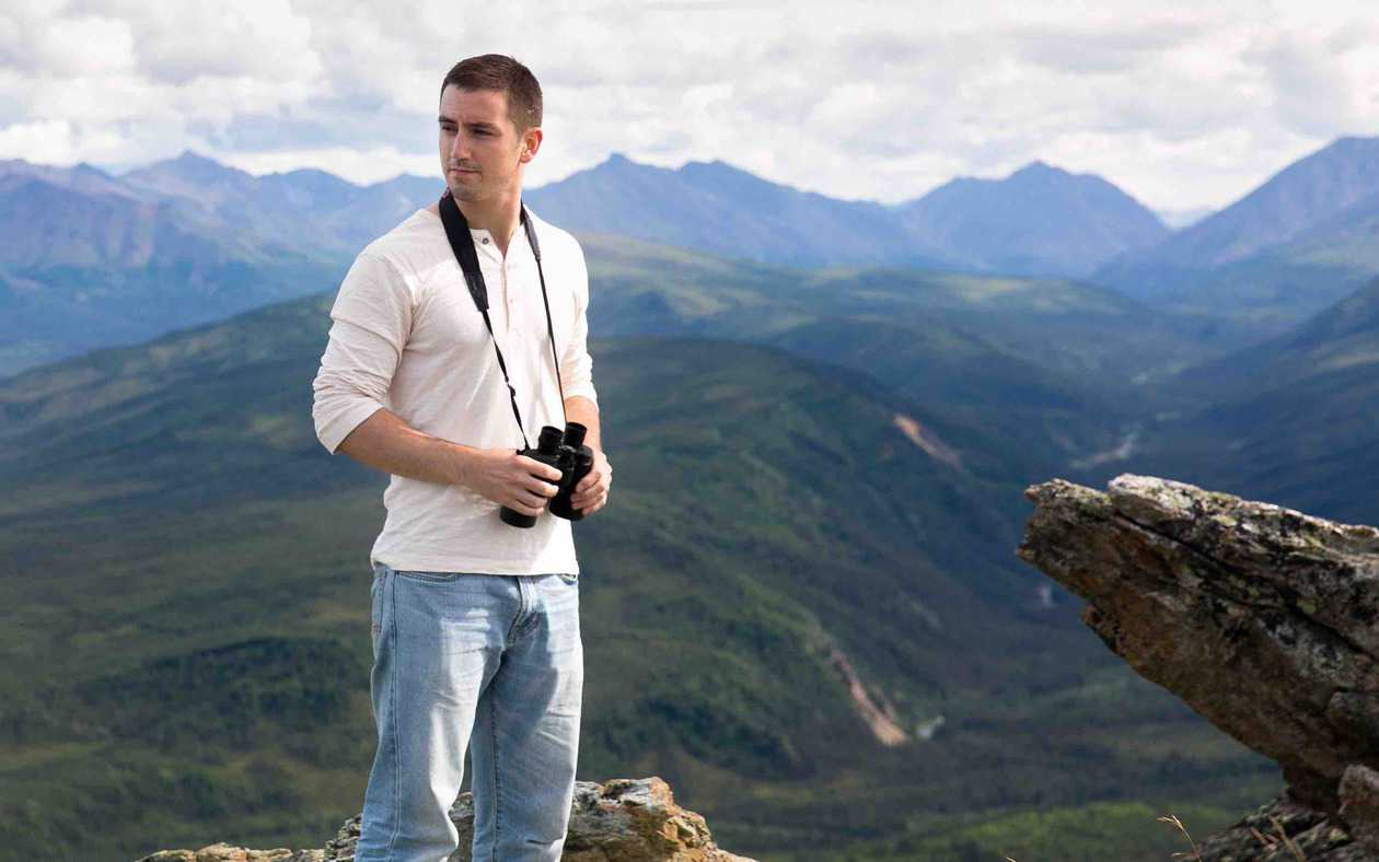Taking in the view at Denali National Park in ManAboutWorld gay travel magazine and Towleroad