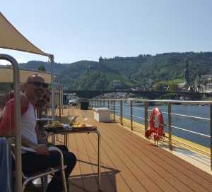 The author and his husband on a river cruise. Uniworld cruise on Towleroad and in ManAboutWorld gay travel magazine