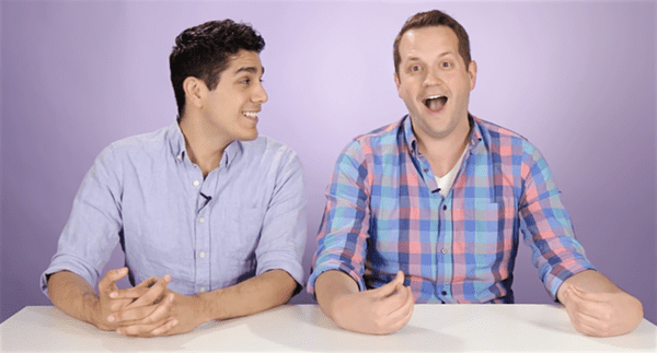 gay couple dresses each other