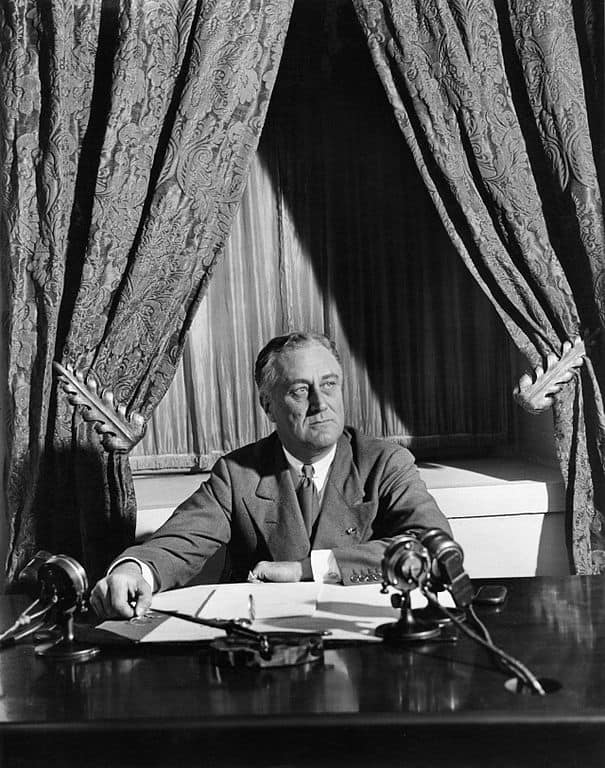 """Franklin D. Roosevelt broadcasts his first """"fireside chat"""" from the White House in 1933. In 1932, he became the last Democratic candidate to be nominated in a contested convention. It was also the last year that Democrats required candidates to receive a two-thirds majority of convention delegates to receive the nomination, a rule implemented in the 1830s to hold the influence of southern Democrats invested in maintaining slavery. Starting in 1936, nominees needed only a simple majority of delegates to secure the nomination. Credit: National Archives and Records Administration/Wikimedia Commons"""