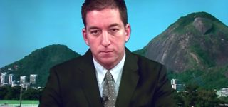 Glenn Greenwald Responds After Brazilian Government Charges Him with Cybercrimes