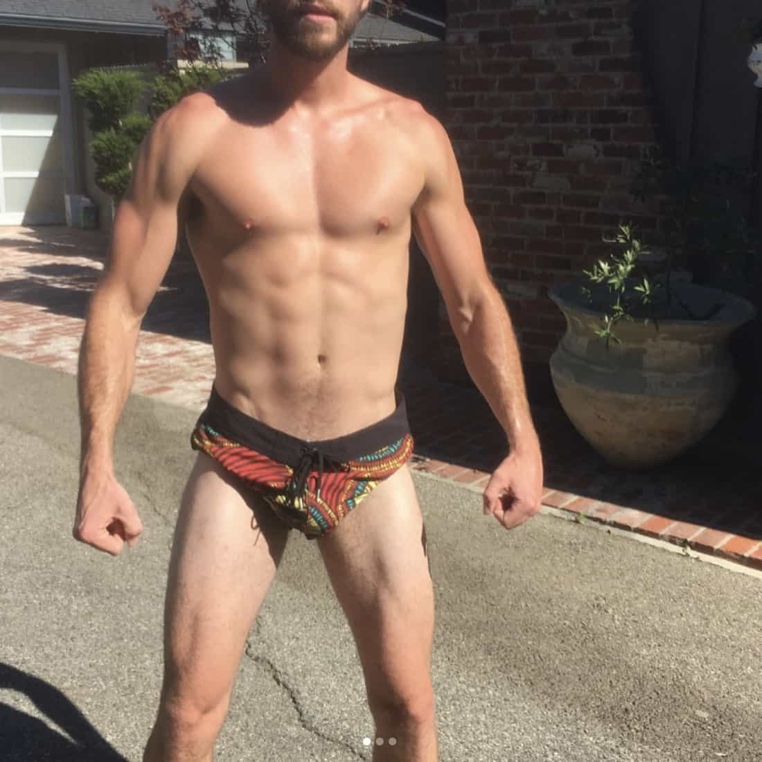 Liam Hemsworth Flexes in Tiny Shorts, Cools Off in an Ice ...