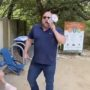 Alex Jones Mocked for Raging at Unfazed Teens About COVID 'Hoax' with Tiny Megaphone: WATCH