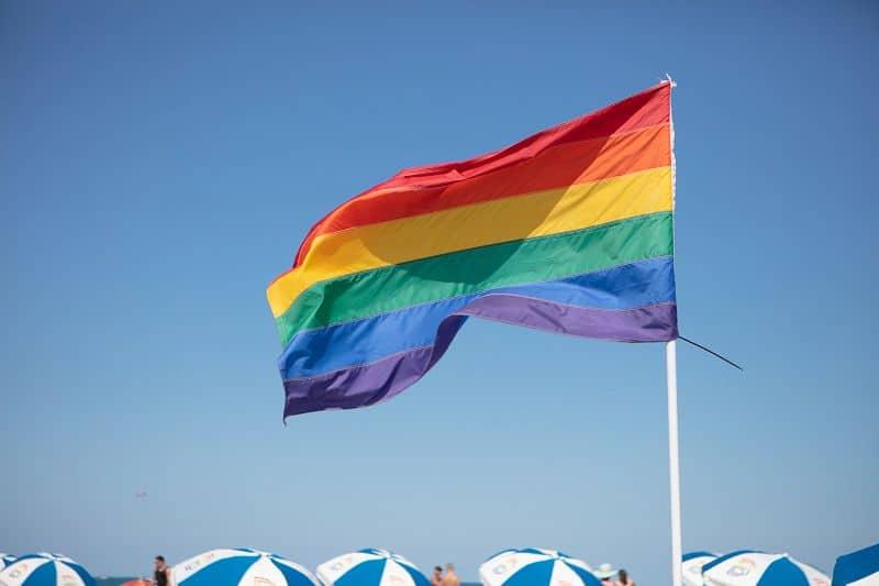 Pride flags along Miami's 12th Street Beach, known as the gay beach, and a hub for the Miami LGBTQ+ community. Photo courtesy of the  GMCVB – http://MiamiandBeaches.com.